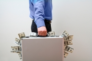 Man holding briefcase full of money
