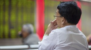 Chinese-Citizens-Watching-Stock-Market_iStoc_Copyright_-FangXiaNuo_72425203_08022016.jpg-A